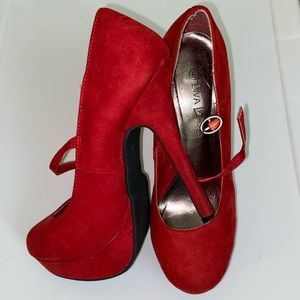 Red platform closed toe pumps with strap
